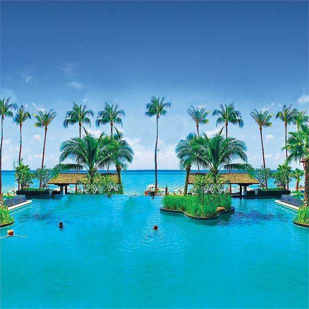 Set on the immaculate beachfront overlooking the clear blue waters of Laem Yai Beach, in a tranquil...