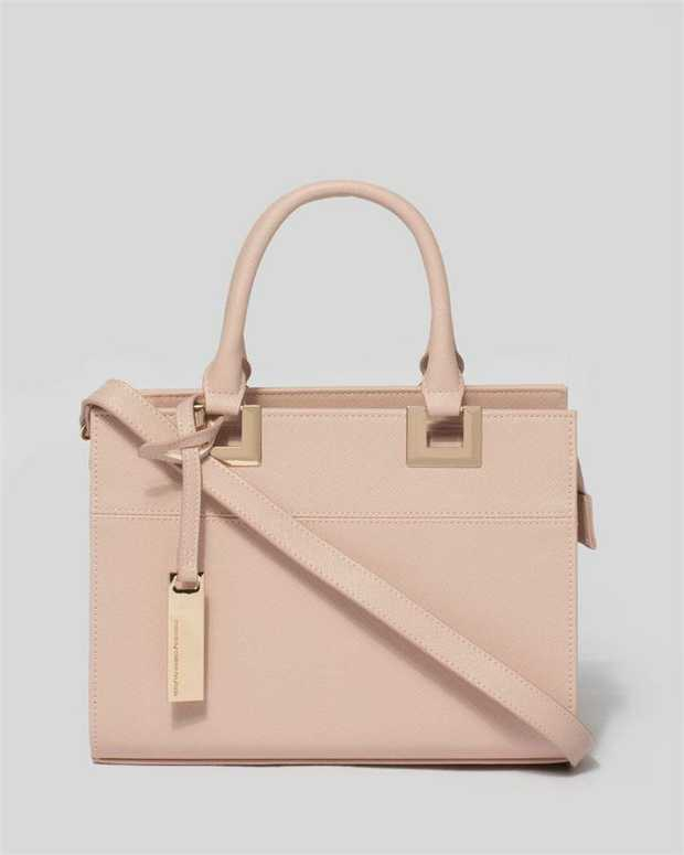 Part of our Stef Mini Classics collection Pink finish with gold tone hardware Detachable tag Saffiano...