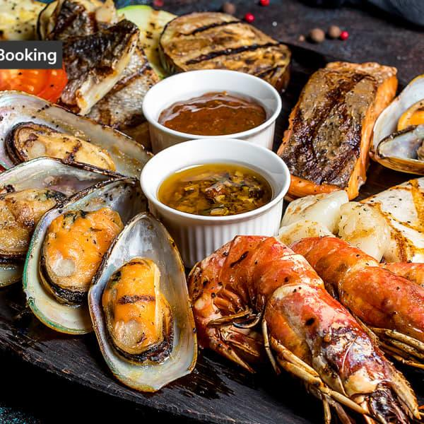 Is there anything better than market-fresh seafood? How about a stack of oceanic delights paired with a...