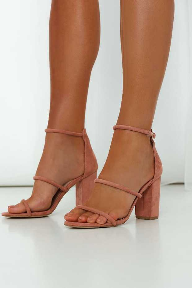 Rose pink upper. Faux suede upper; non-leather lining and sole. Gold-buckled ankle strap.  Covered...