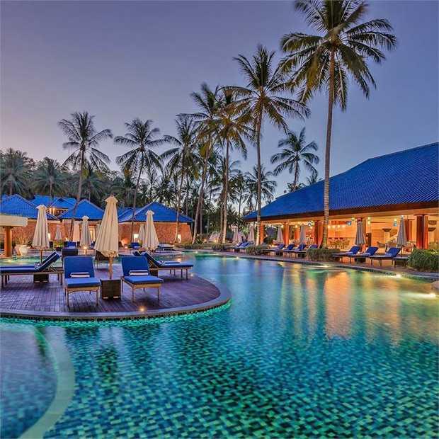 Escape to Lombok—Bali's pristine sister island—for a serene beachfront escape amid the white sands...