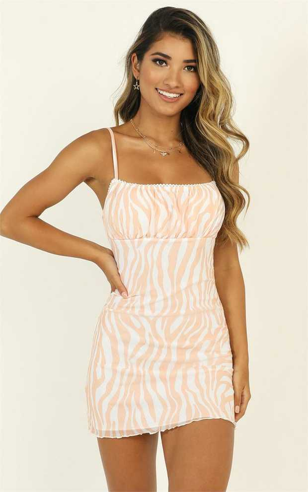 This is the cutest dress around. The Walls Caving In Dress features animal print detailing, a mini...