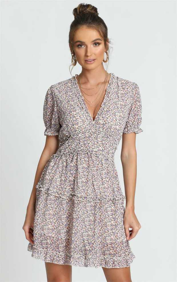 Turn heads in the Losing My Marbles Dress! Featuring floral detailing, a plunging neckline and short...