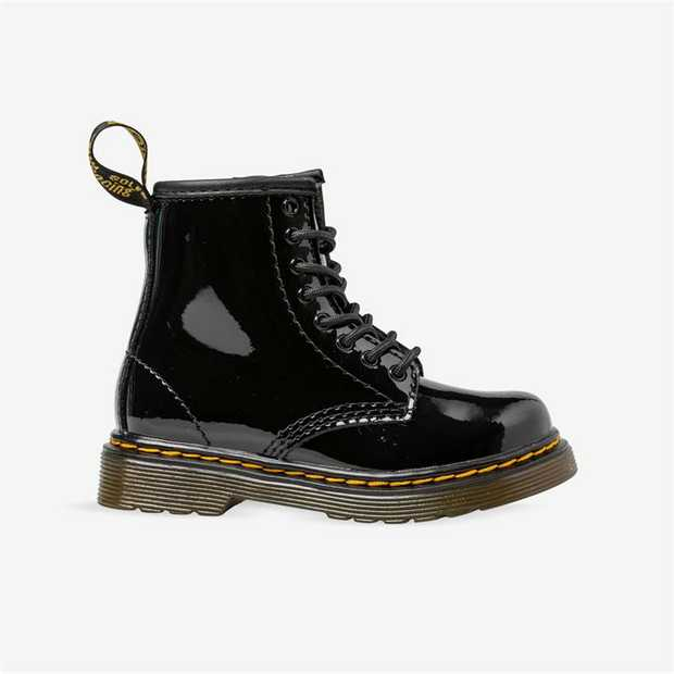A mini 1460 for toddlers, this patent leather boot features an ankle zip for little fingers (and...