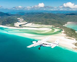 Enjoy a 60 minute scenic flight over the Whitsunday Islands and Great Barrier Reef, including Heart...