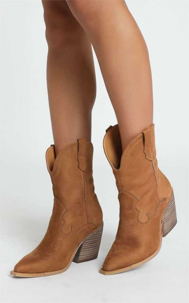 Millie is a western inspired below the knee boot, showing off a faux suede upper with western inspired...