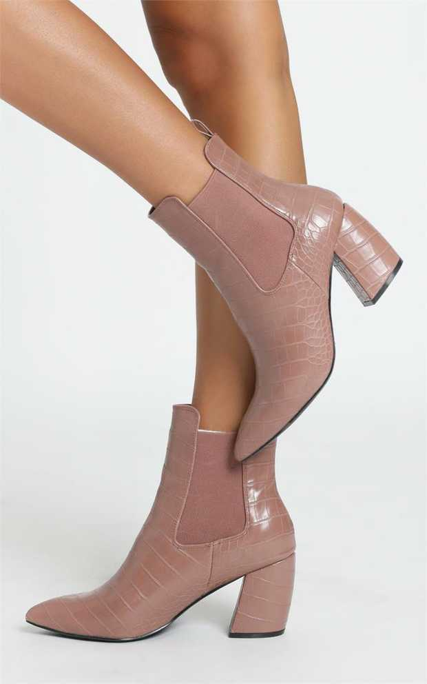 SteelebyTherapyboot offers a banana-shaped heel, a pointed toe in a faux croc...