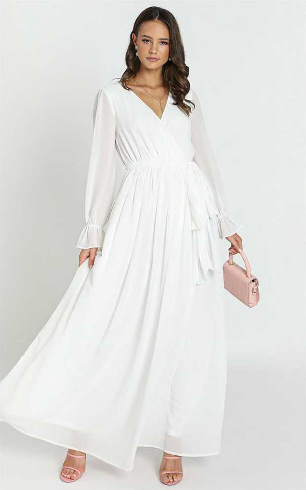 Turn heads in this stunning piece! Featuring a maxi length and sheer sleeves and back, it is the...