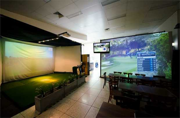TrackMan Golf Simulator - 2 Pro Lessons and 18 Holes of Golf: This experience includes 2 x 30-minute...