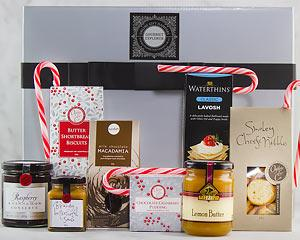 Spread some Christmas cheer with this Gourmet Hamper full of Festive Treats delivered right to their...