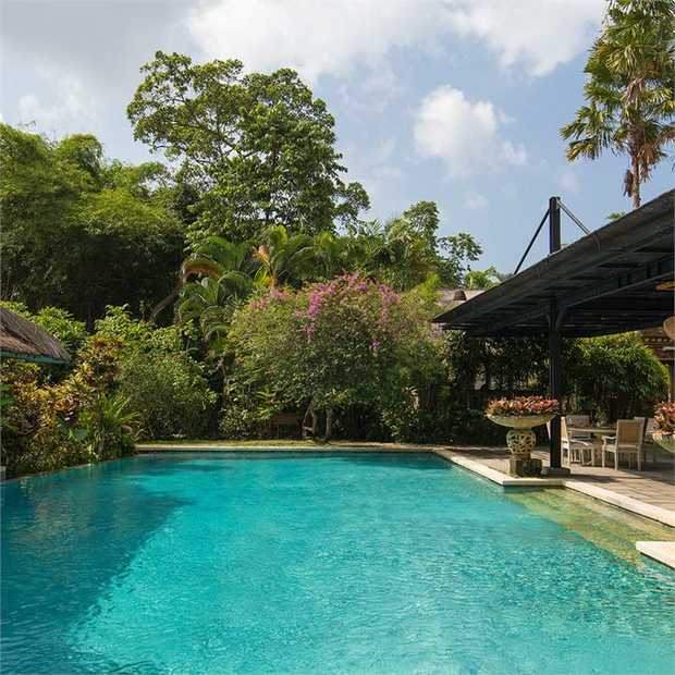 Unwind amid verdant tropical gardens and paddy fields, staying in a traditional Indonesian villa at...