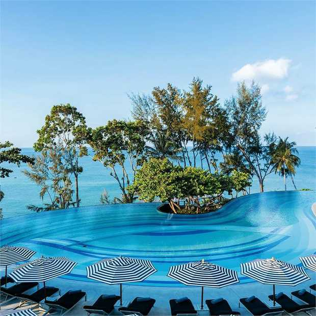Revel in a sun-kissed escape at the five-star Pullman Phuket Arcadia Naithon Beach, an oceanfront...