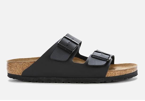 The Arizona sandal by Birkenstock is a double adjustable strap with a corked footbed and EVA...