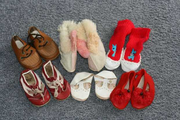 6 pair shoes/slippers size 1 and 2 including pink genuine Ugg slippers size 2. All in good condition.