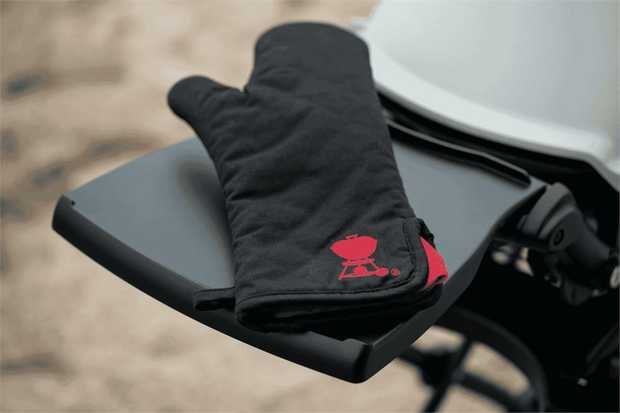 Protect your hands and look like a pro doing so. The Weber Barbecue Mitt keeps your hand and forearm...
