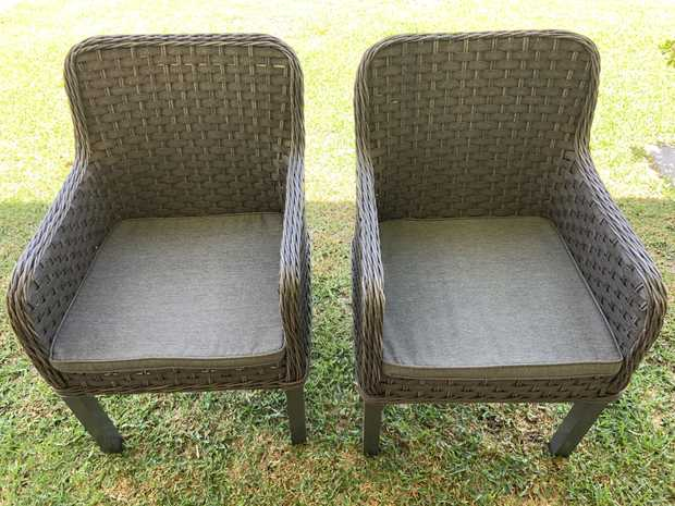 excellent condition.    heavy metal timber like table and six wicka arm chairs