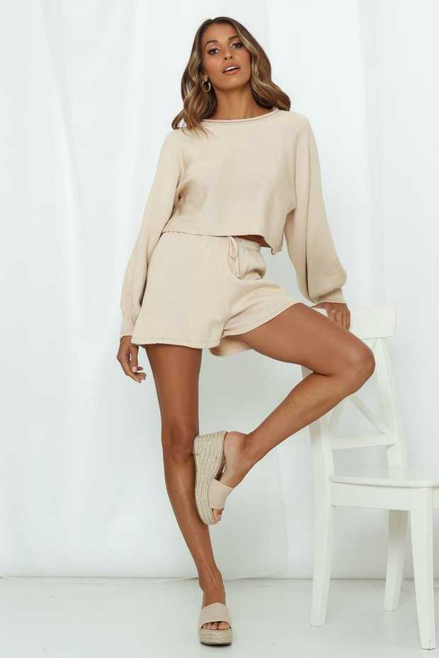 Length from waist to hem of size S: 38cm.Beige knit shorts.Non-lined.Cold hand wash only.Model is a...