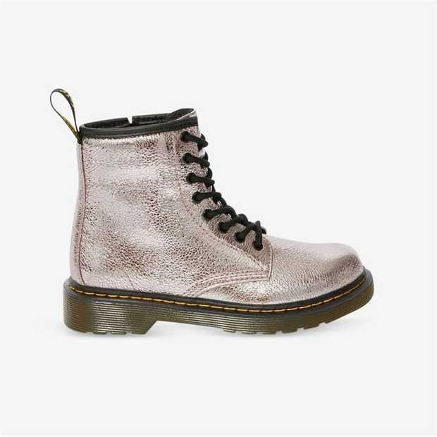 Mini Docs make the most noise: these 1460 boots are built from a crackled metallic material that...