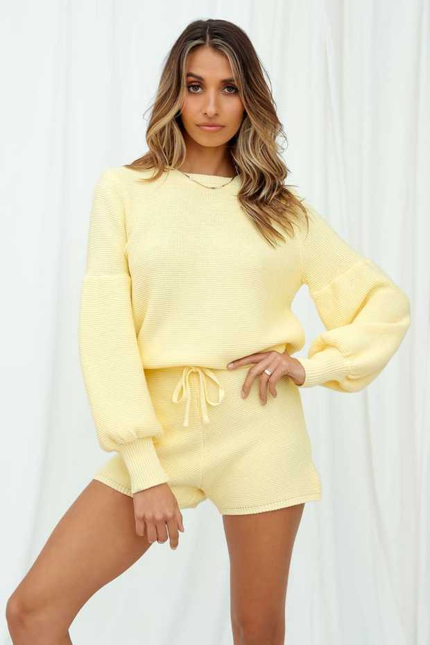 Length from shoulder to hem of size S: 56cm.Yellow knit top.Non-lined.Cold hand wash only.Model is a...