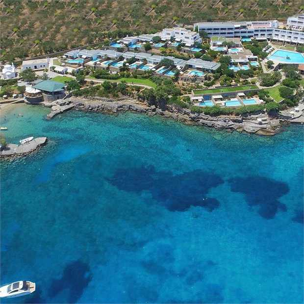 Escape to the sun-soaked Greek island of Crete staying at the Elounda Mare Hotel, complete with its own...