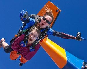 Get your heart racing with a 12,000ft tandem skydive over South Australias picturesque Lake...