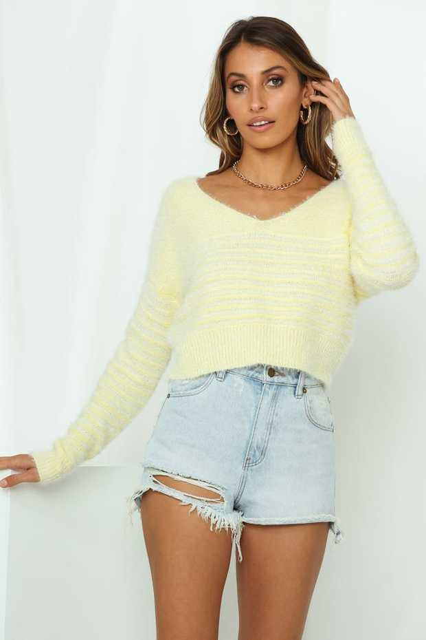 Length from shoulder to hem of size S: 52cm. Yellow knit jumper. Non-lined. Cold hand wash...