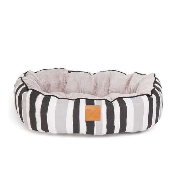 The Mog & Bone 4 Seasons Circular Dog Bed Pebble Black Brush is a versatile, reversible bed...