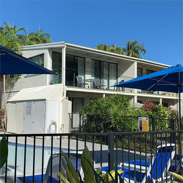 The sun-kissed scenery of Port Douglas beckons at Beachfront Terraces, a relaxed oasis located a...
