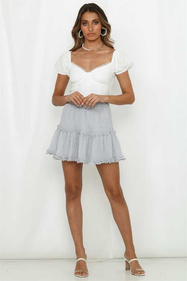 Length from waist to hem of size S: 42cm. Grey mini skirt. Lined. Cold hand wash only.  Model is a...