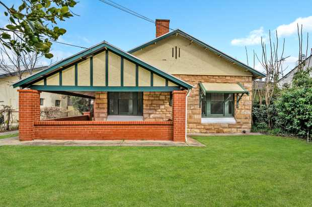 Sandstone Bungalow of 7 main rooms.