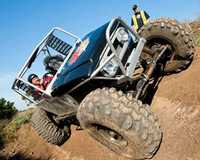 This off-road four-wheel tough truck driving experience will have you driving along walls - and...