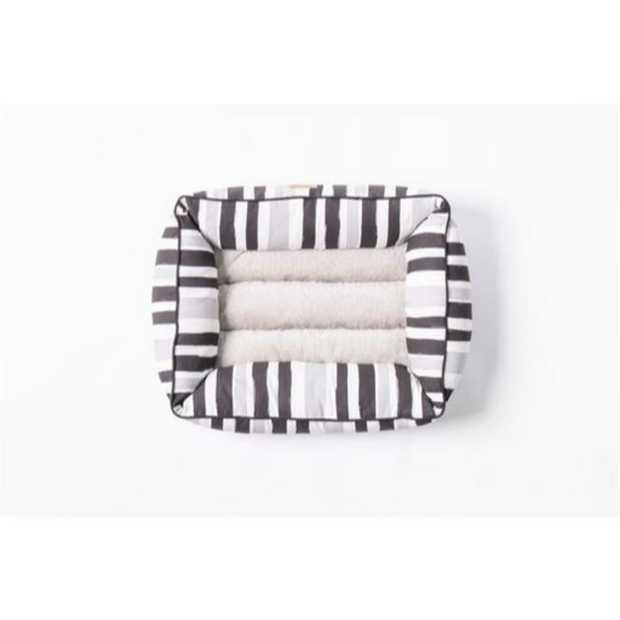 The Mog & Bone Bolster Bed Pebble Black Brush is a gorgeous comfy bed that will let your dog...