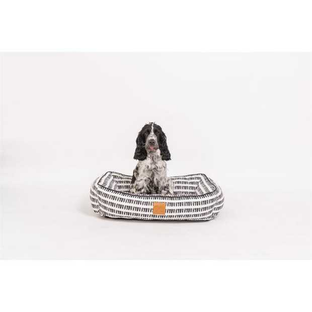 The Mog & Bone Bolster Bed Black Mosaic is a gorgeous comfy bed that will let your dog snuggle...