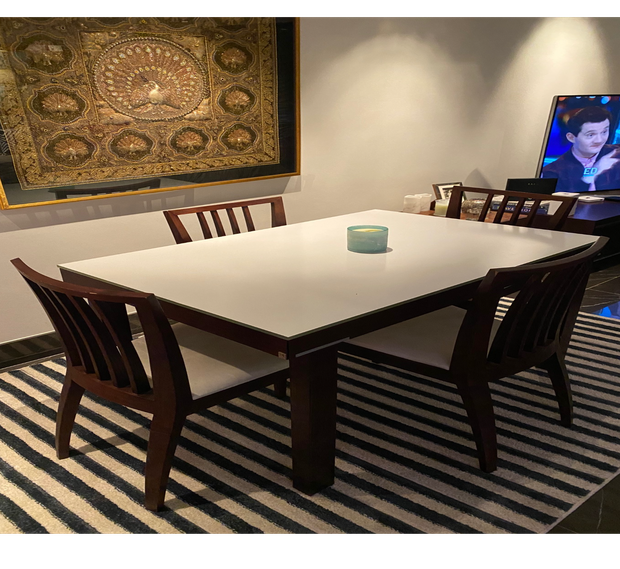 Extendable dining table in good condition.Comprises of wooden structure with white glass central insert...