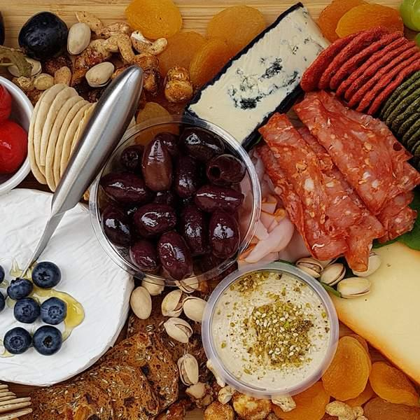 Take the stress out of entertaining with a gourmet cheese platter curated by the platter queens at...