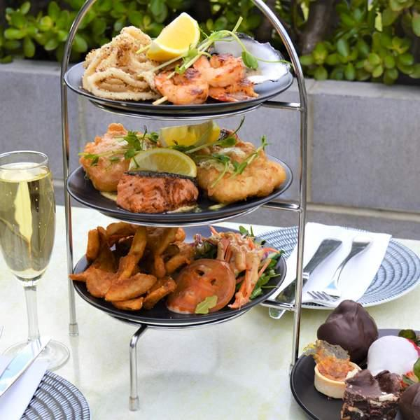 Thai marinated prawns, grilled salmon with dill mayo, fresh oysters, dark chocolate profiteroles...