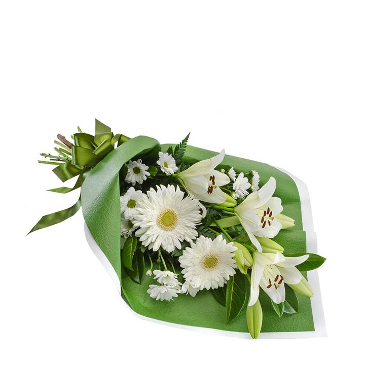 A beautiful arrangement of all white blooms expertly handcrafted and wrapped in green paper and ribbon.