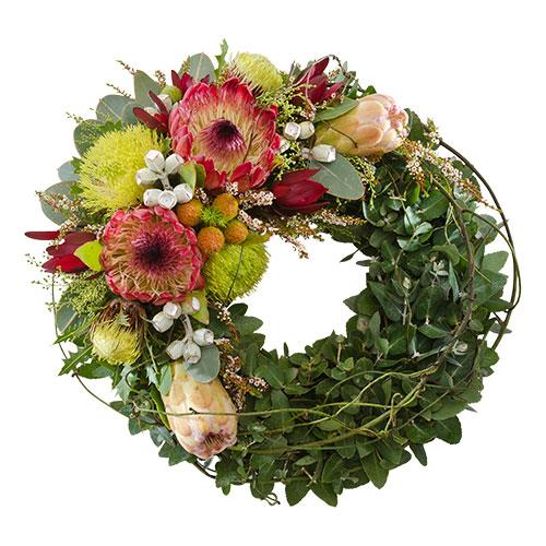 This wreath of wildflowers features Australiana themed blooms and traditional laurel leaves. Suitable...