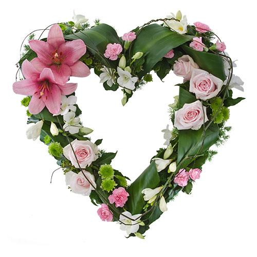 This sympathy heart features flowers in tones of pink with touches of white and green. A thoughtful...