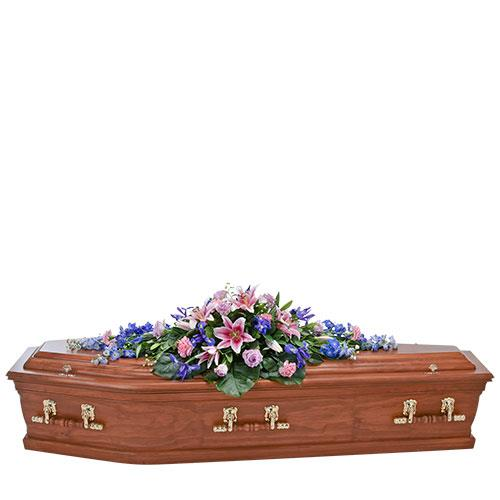 This coffin spray combines pink and purple flowers of mixed varieties including lily, rose, and iris. A...