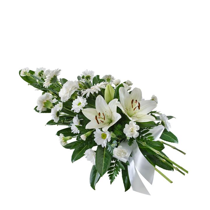 This stunning sympathy spray is an all-white floral tribute that thoughtfully expresses love for a dear...