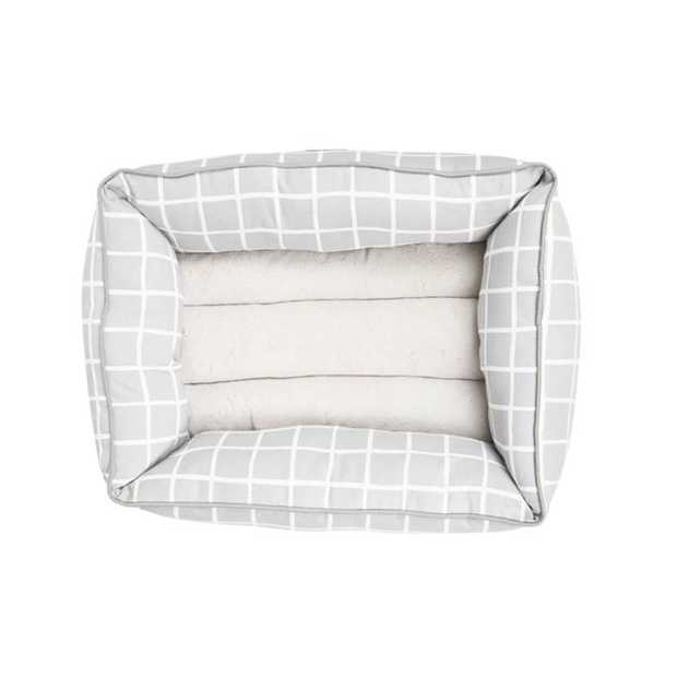 The Mog & Bone Bolster Bed Grey Check  is a gorgeous comfy bed that will let your dog snuggle in...