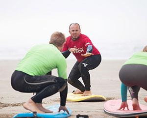 Take the plunge and hit the water for an exciting surfing lesson at Long Beach in Robe, South...