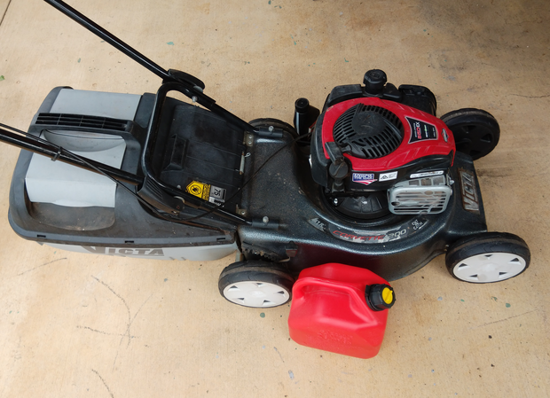 Victa 4-Stroke Lawn Mower with Catcher and fuel can.