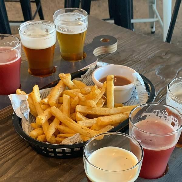 What's better than kicking back with a craft beer (or two) and some grub? Doing it with friends of...