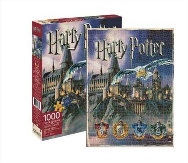 Depicting the famous school, Hogwarts, and its four house crests, Gryffindor, Hufflepuff...