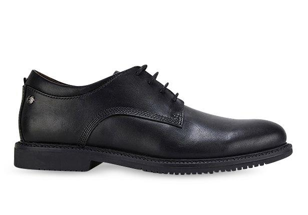 The Clarks Dallas is a sleek, black lace-up school shoe featuring a moulded heel Union Jack footbed.