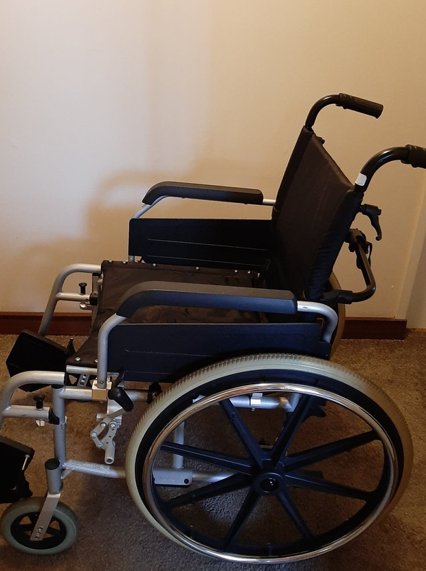 Push wheel chair, has foot rests, brakes, large detachable wheels, easily fold down, easy to push.