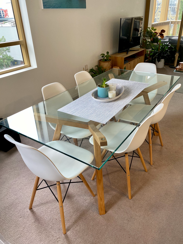 Matt Blatt brand glass dining table (1800mm x 900mm) with 6 white replica Eames dining...