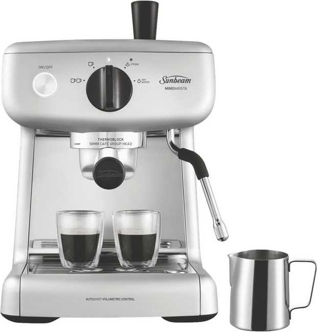 This Sunbeam coffee machine's espresso maker helps you make coffee drinks easily. It has a silver...